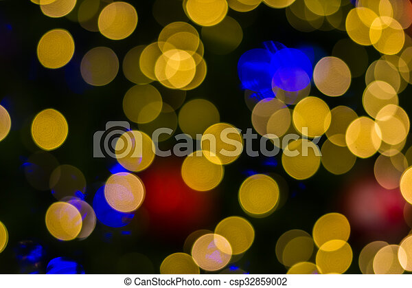 Defocused ligths of golden Christmas tree - csp32859002