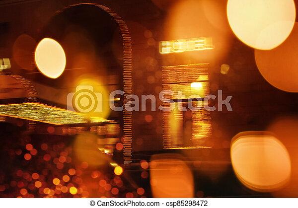 Defocused night city scene with Hotel sign - csp85298472