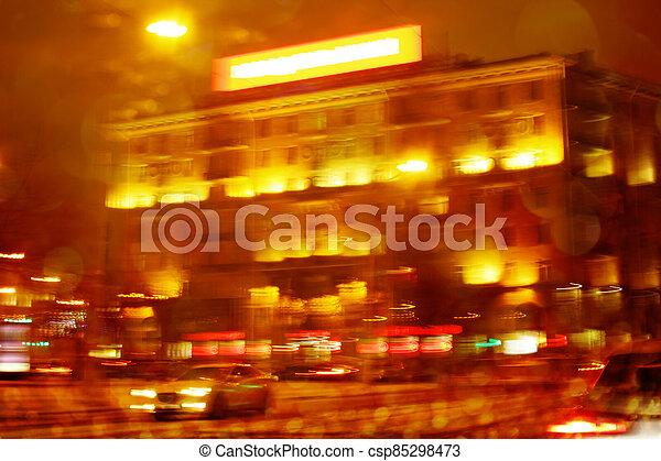 Defocused night city scene with orange illumination - csp85298473
