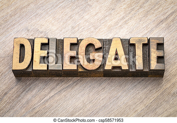 delegate word abstract in wood type - csp58571953