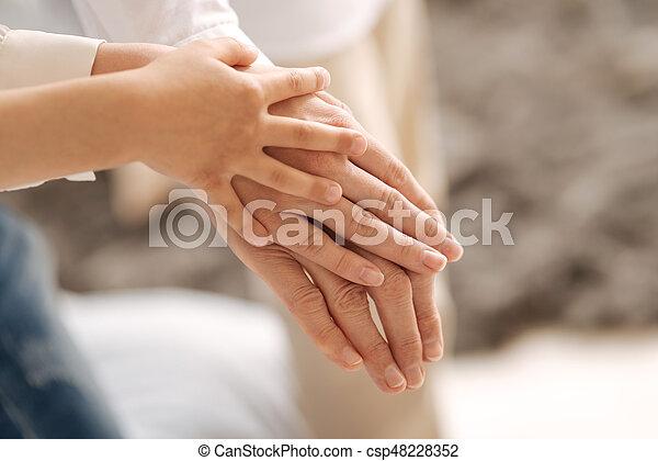 Delicate female hands of three generations - csp48228352