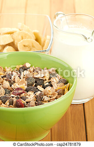 Delicious and healthy cereal in bowl with milk - csp24781879