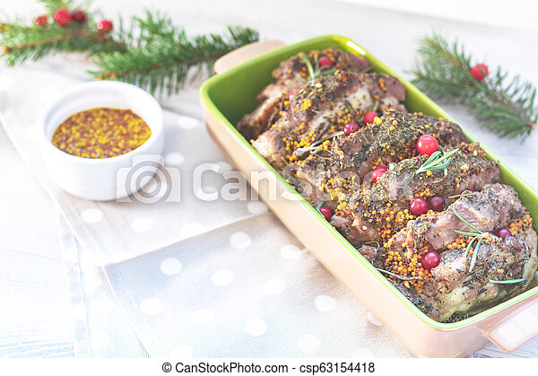 Delicious baked meat with cranberry and spices - csp63154418