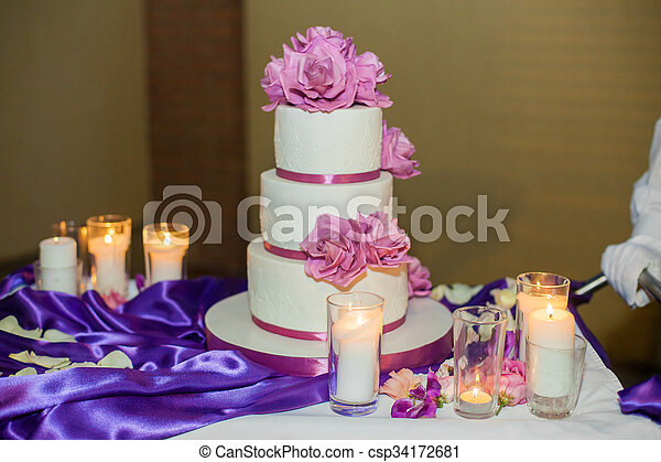 Delicious beautiful white wedding cake with purple flowers delicious beautiful white wedding cake with purple flowers csp34172681 mightylinksfo