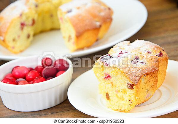Delicious Cake with Raisins and Cranberries - csp31950323