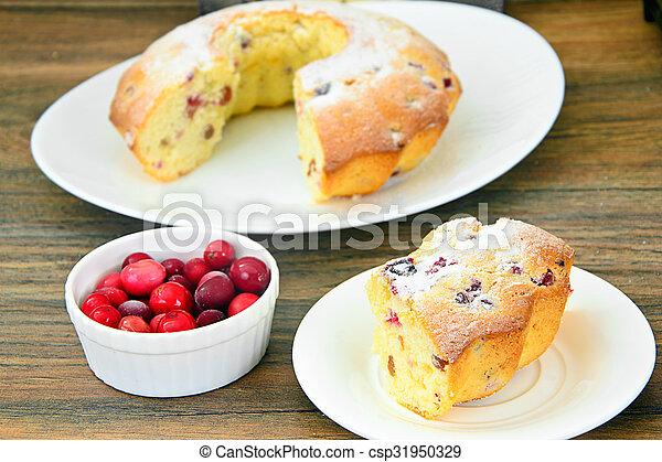 Delicious Cake with Raisins and Cranberries - csp31950329