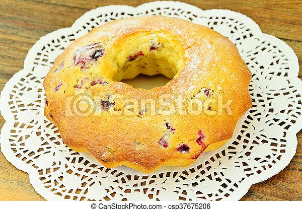 Delicious Cake with Raisins and Cranberries - csp37675206
