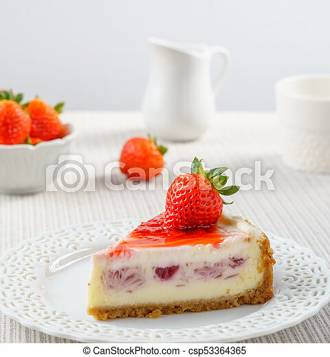 Delicious cheesecake with strawberry on a table against white wall. - csp53364365