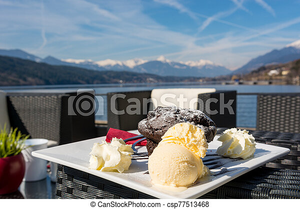 Delicious chocolate muffin served with vanilla ice cream. - csp77513468