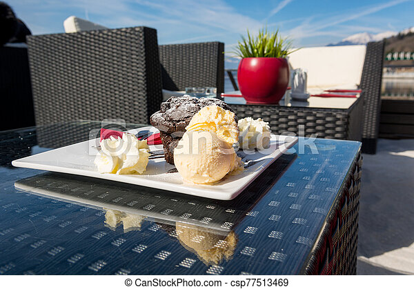 Delicious chocolate muffin served with vanilla ice cream. - csp77513469