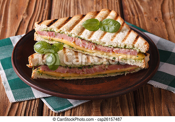 Delicious grilled sandwich with ham, cheese and basil - csp26157487