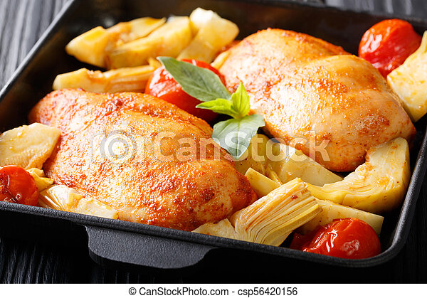Delicious healthy food: chicken breast with artichokes and tomatoes close-up. horizontal - csp56420156