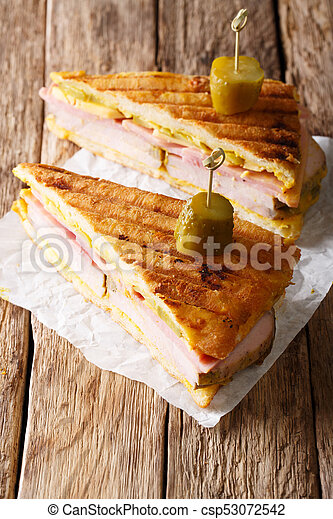 Delicious hot Cuban sandwich close-up on the table. vertical - csp53072542