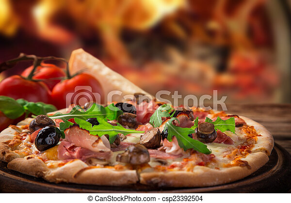 Delicious italian pizza served on wooden table - csp23392504