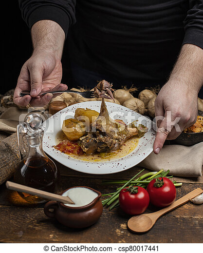 delicious meat meal with garlic on dark background - csp80017441
