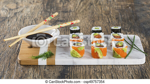 Delicious mixed sushi arranged on white marble surface - csp49757354