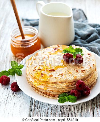Delicious pancakes with raspberries - csp61584219