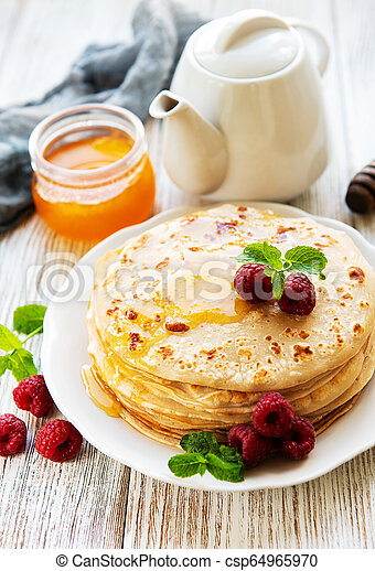 Delicious pancakes with raspberries - csp64965970