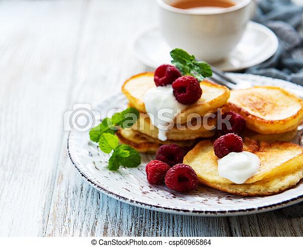 Delicious pancakes with raspberries - csp60965864