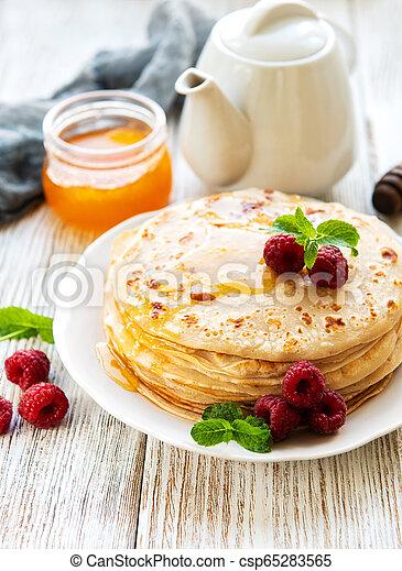 Delicious pancakes with raspberries - csp65283565
