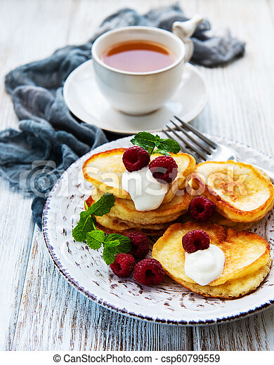 Delicious pancakes with raspberries - csp60799559