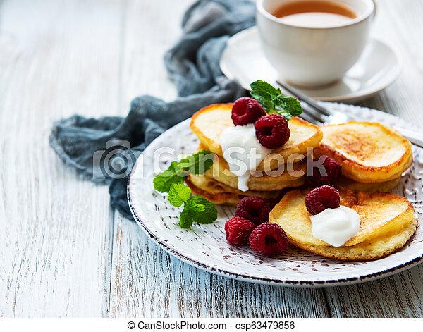 Delicious pancakes with raspberries - csp63479856