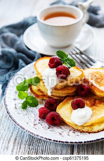 Delicious pancakes with raspberries - csp61375195