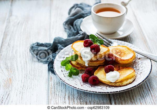 Delicious pancakes with raspberries - csp62983109