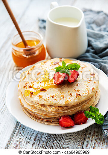 Delicious pancakes with strawberry - csp64965969