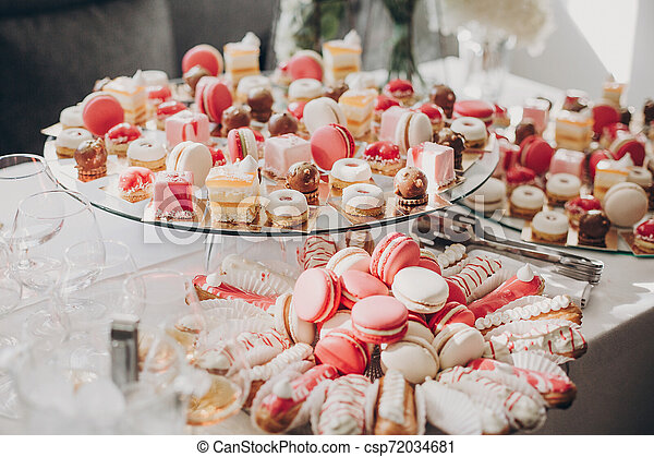 Delicious Pink Candy Bar At Wedding Reception Pink And White Desserts Macarons And Cupcakes On Stand Modern Sweet Table At