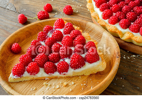 Delicious raspberry tarts on a wooden board - csp24783560