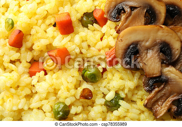 Delicious rice with vegetables and mushrooms background, close up - csp78355989