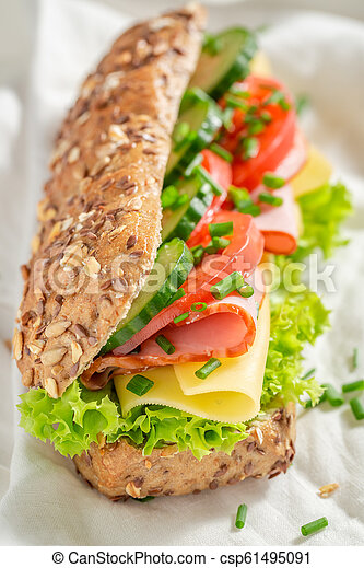 Delicious roll with cheese, ham and cucumber for breakfast - csp61495091
