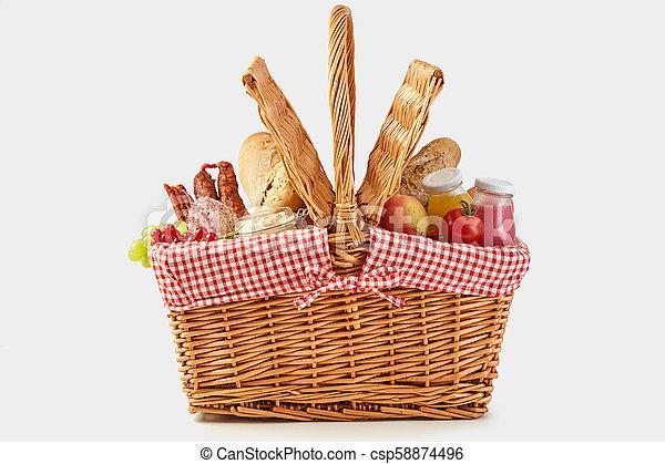 Delicious summer picnic food in a wicker hamper - csp58874496