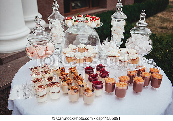 Delicious wedding reception candy bar dessert table. swetts, cupcakes.