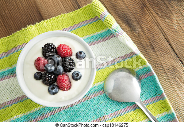 Delicious yogurt and fresh berries for breakfast - csp18146275