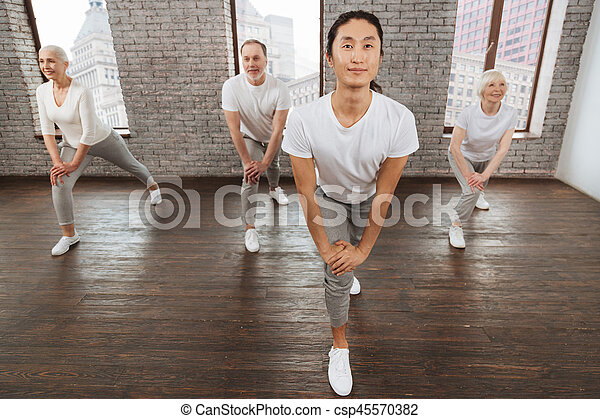 Delighted Asian man bent his back - csp45570382