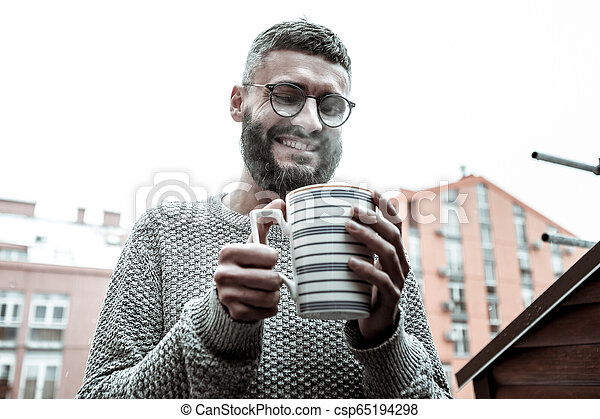 Delighted happy man wanting to drink his coffee - csp65194298