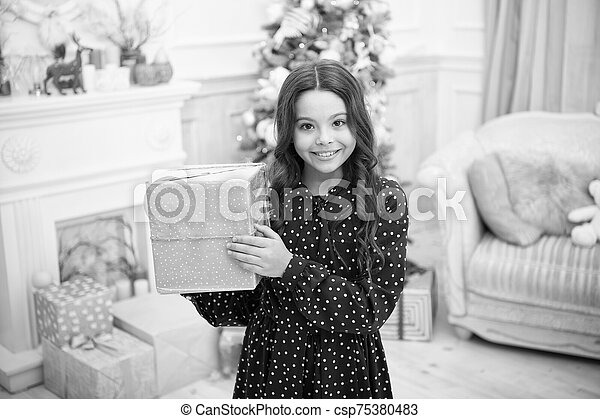 delivery christmas gifts. happy new year. happy little girl celebrate winter holiday. christmas time. Cute little child girl with xmas present. New Year is coming. What is inside - csp75380483