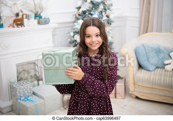 delivery christmas gifts. happy new year. happy little girl celebrate winter holiday. christmas time. Cute little child girl with xmas present. New Year is coming. What is inside - csp63996497