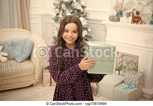 delivery christmas gifts. happy new year. happy little girl celebrate winter holiday. christmas time. Cute little child girl with xmas present. New Year is coming. What is inside - csp73619494