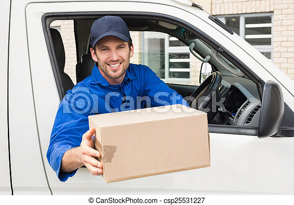 Delivery driver offering parcel from his van outside the... stock ...