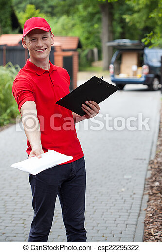 Delivery guy giving a packet - csp22295322