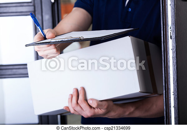 Delivery man asking for a signature - csp21334699