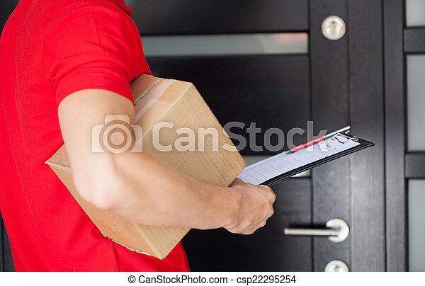 Delivery man at front door - csp22295254