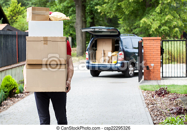Delivery man carrying package stack - csp22295326