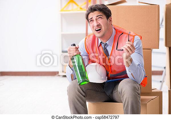 Delivery man drunk at work - csp58472797