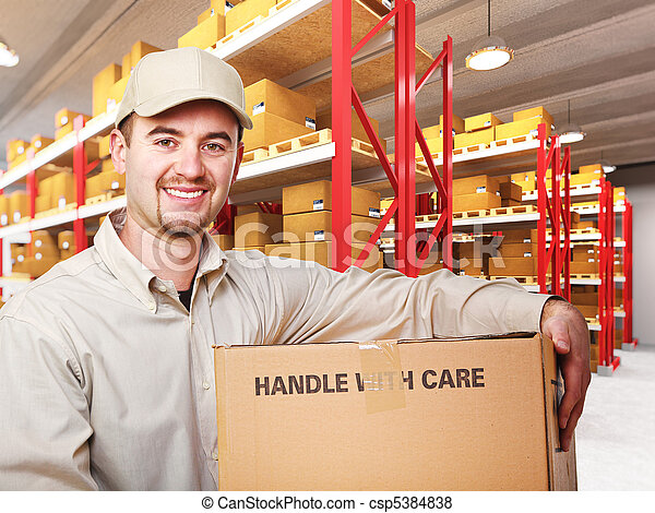 delivery man in warehouse - csp5384838