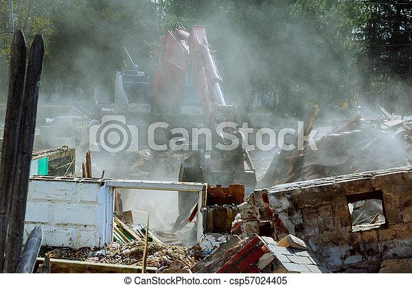 Demolish building with debris in city, broken house on ruin demolishing - csp57024405