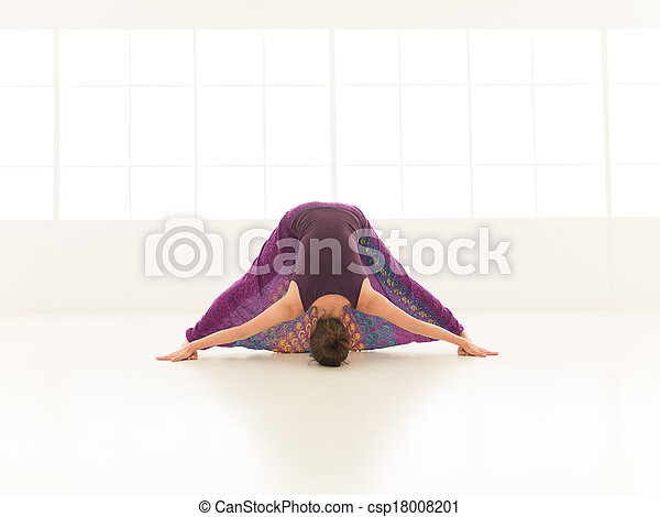 demonstration of difficult stretching yoga pose young